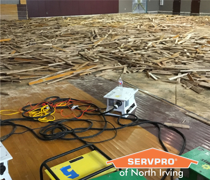 ruined school basketball court after commercial water damage