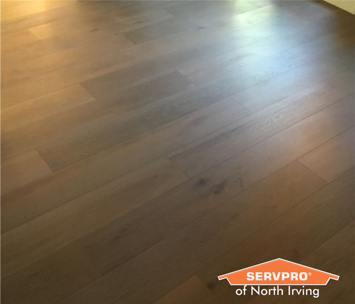 brown hardwood floor reconstruction after water damage