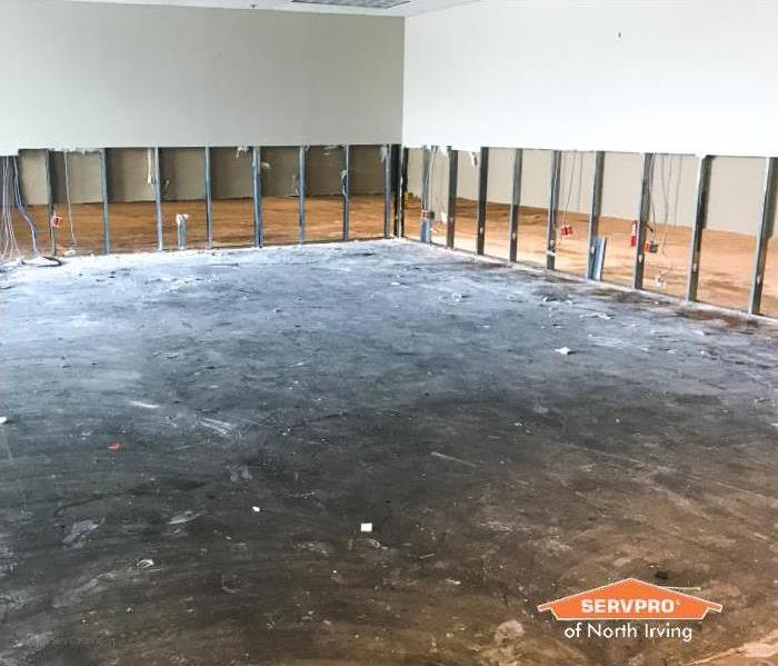 commercial property has drywall cut up to 6 feet after water damage