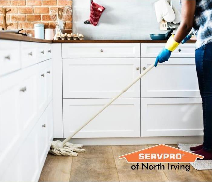 cleaning kitchen floors with mop