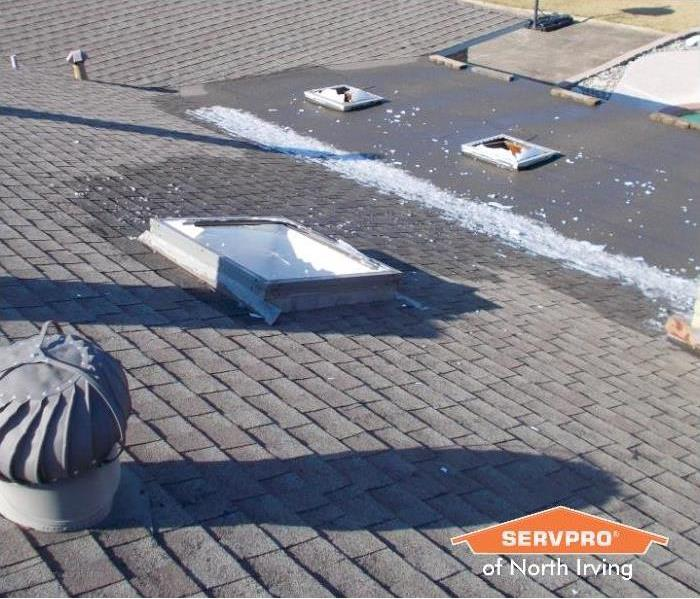 rooftop with skylights broken after a hail storm